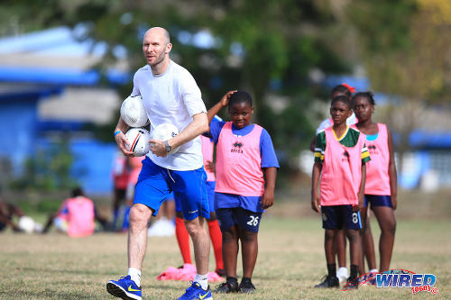Photo: Sam Parkin instructs participants during the Flow Legends Community Legacy Outreach programme at Speyside Recreational Grounds, Tobago. (Courtesy Allan V Crane/Wired868)