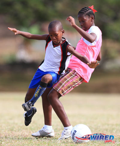 Photo: Two young players show their stuff during a British Airways Tobago Football Legends camp at the Speyside Recreation Grounds, Tobago. (Courtesy Allan V Crane/Wired868)