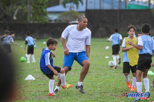Photo: Former Liverpool FC star Stan Collymore (centre) trains with some young players during the British Airways Tobago Legends Football Challenge's community outreach programme at the St Mary's College ground, Serpentine Road. (Courtesy Sinead Peters/Wired868)