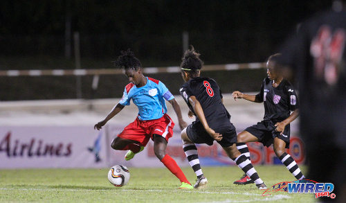 Photo: Wave captain Kennya Cordner (left) is chased by Oilers players Victoria Swift (centre) and Chevonne John during WPL action in Palo Seco. (Courtesy Sinead Peters/Wired868)