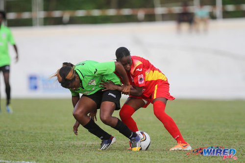Photo: Dragons midfielder Neise Dadie Va (right) uses unconventional methods to stop Rush attacker Mariah Shade during 2015 WPL action at Palo Seco. (Courtesy Sinead Peters/Wired868)