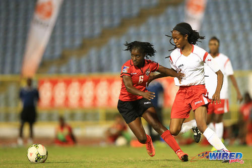 Photo: Trinidad and Tobago defender Khadidra Debesette (left) holds off a WPL player Zaudita Kaza-Amlak (US Virgin Islands) during a scrimmage match in 2015. (Courtesy Allan V. Crane/Wired868)