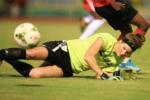 Photo: WPL goalkeeper Emily Cota from the US Virgin Islands pulls off a save in a scrimmage against the Women Soca Warriors. (Copyright Allan V Crane/SPORTT)