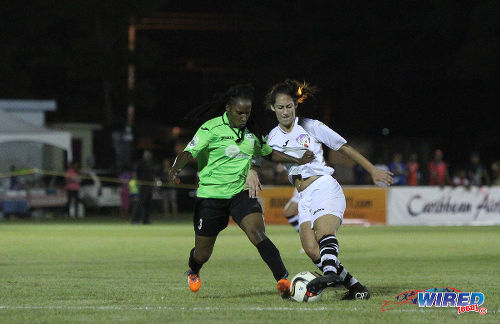 Photo: Angels midfielder Jodol Sokol (right) tames on Rush defender Adika Spence during last night's WPL action in Tacarigua. (Courtesy Sinead Peters/Wired868)