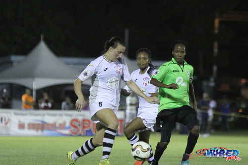 Photo: Angels defender Jaclyn Poucel (left) closes down Rush captain Ahkeela Mollon (right) while teammate Ayanna Russell looks on in last night's WPL action at Tacarigua. (Courtesy Sinead Peters/Wired868)