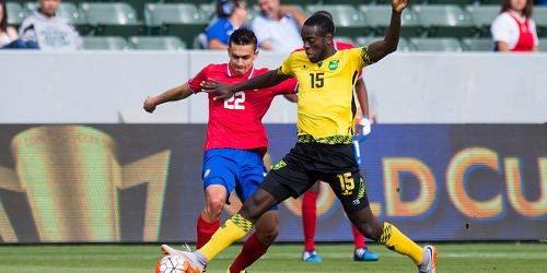 Photo: Jamaica midfielder Je-Vaughn Watson (right) challenges Costa Rica player Jose Cubero during 2015 CONCACAF Gold Cup action. (Courtesy CONCACAF)