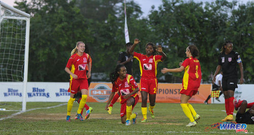 Photo: Dragons goal scorer Dernelle Mascall (centre) is congratulated by teammates (from right)  Jessica Adams, Sharee Guerra and Isabella Hayes after her goal against Petrotrin Oilers in Sangre Grande. (Courtesy Sinead Peters/Wired868)
