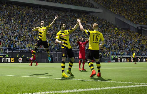 Photo: Borussia Dortmund players celebrate during a FIFA 15 game.
