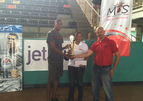 "Photo: Trinidad and Tobago Interactive Football Cup finalist Javon ""Slick"" Charles (left) collects his North Zone trophy from Sport Ministry official Kevin Harrison (right) and another staff member. (Courtesy Carlon Garcia)"