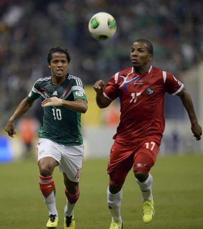 Photo: Mexico's Giovani Dos Santos (left) and Panama's Luis Henriquez contest the ball during the 2014 World Cup qualifying campaign. (Copyright Alfredo Estrella/AFP 2015)
