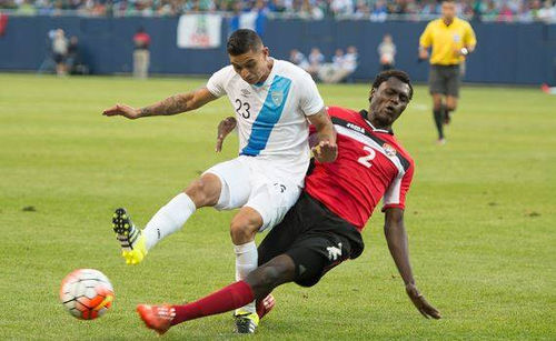 Photo: Trinidad and Tobago defender Aubrey David (right) tackles Guatemala midfielder Jorge Aparicio in the 2015 CONCACAF Gold Cup. (Courtesy CONCACAF)