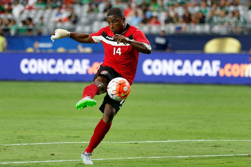 Photo: Trinidad and Tobago midfielder Andre Boucaud volleys home the second goal in their 2-0 win over Cuba at the 2015 CONCACAF Gold Cup. (Copyright Christian Peterson/AFP 2015)