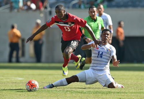 Photo: Trinidad and Tobago winger Cordell Cato (left) eludes Panama midfielder Miguel Camargo during the 2015 CONCACAF Gold Cup quarterfinal. (Copyright Jewel Samad/AFP 2015)