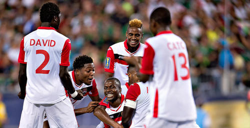 Photo: Trinidad and Tobago midfielder Keron Cummings (centre) celebrates his goal against Mexico with teammates (from right) Cordell Cato, Joevin Jones, Mekeil Williams and Aubrey David in the 2015 Gold Cup. (Courtesy MexSport/CONCACAF)