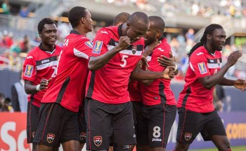 Photo: Trinidad and Tobago players celebrate after a goal in their opening 2015 CONCACAF Gold Cup match against Guatemala. (Courtesy CONCACAF)
