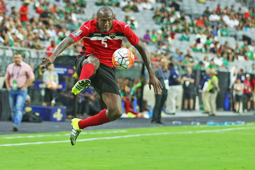 Photo: Trinidad and Tobago right back Daneil Cyrus controls the ball during 2015 CONCACAF Gold Cup action against Cuba. (Courtesy: Arianna Grainey)