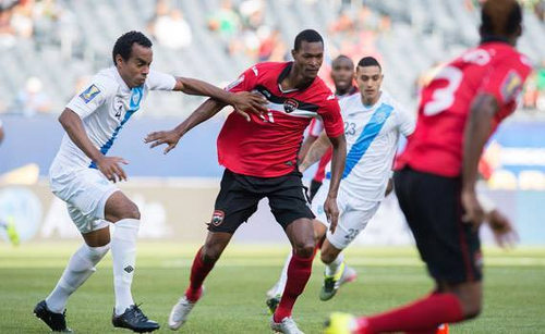 Photo: Trinidad and Tobago attacker Ataulla Guerra (centre) tries to hold off Guatemala defender Wilson Lalin during 2015 CONCACAF Gold Cup action. (Courtesy CONCACAF)