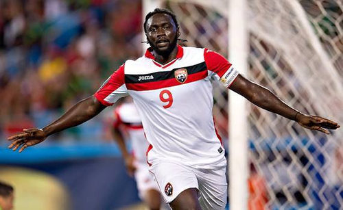Photo: Trinidad and Tobago captain Kenwyne Jones celebrates his goal against Mexico in the 2015 CONCACAF Gold Cup. Jones will miss the rematch between the two teams on September 4 in Utah. (Courtesy CONCACAF)