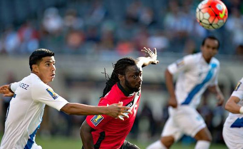 Photo: Trinidad and Tobago captain Kenwyne Jones (centre) in action against Guatemala in the opening Group C 2015 CONCACAF Gold Cup match. (Courtesy CONCACAF)