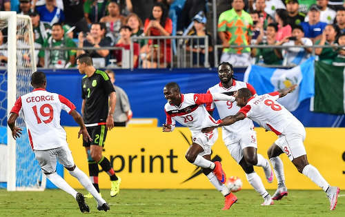 Photo: Trinidad and Tobago midfielder Keron Cummings (third from right) celebrates his second strike against Mexico with teammates (from right) Khaleem Hyland, Kenwyne Jones and Kevan George at the CONCACAF Gold Cup. (Copyright Nicholas Kamm/AFP 2015)