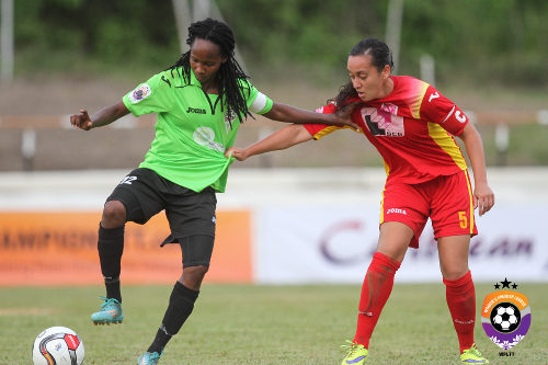 Photo: Wave captain Ahkeela Mollon (left) tries to hold off Dragons captain Arin King during WPL action in Palo Seco. (Courtesy Sinead Peters/WPL)