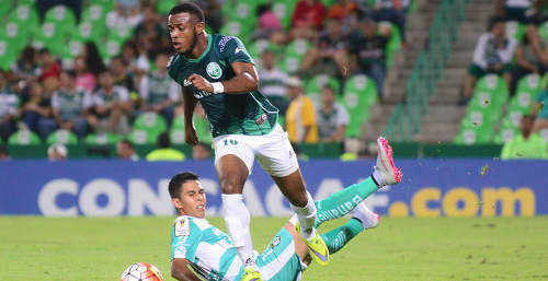 Photo: W Connection attacker Jomal Williams (right) in action against Santos Laguna in the CONCACAF Champions League. (Copyright CONCACAF)