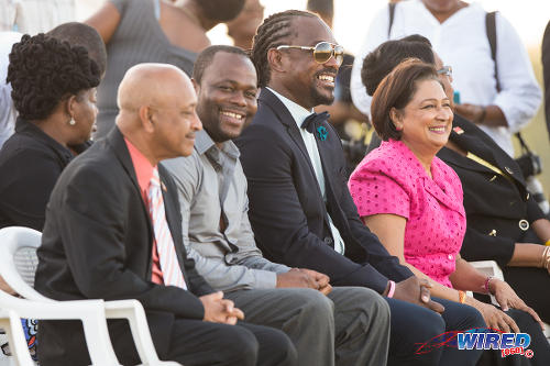Photo: Sport Minister Brent Sancho (second from right) is flanked by Prime Minister Kamla Persad-Bissessar (right) and former World Cup 2006 star Stern John during the opening of the Irwin Park Sporting Complex in Siparia. (Courtesy Allan V Crane/Wired868)