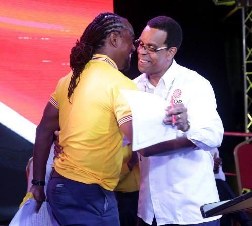Photo: Former PP Minister and Arima MP Pastor Rodger Samuel (right) greets ex-Sport Minister Brent Sancho.