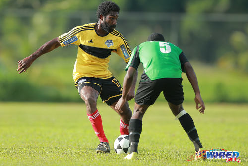 Photo: Cunupia FC striker Steve Stoute (left) takes on Prisons FC defender Sean Diaz during 2015 CNG National Super League Championship Division action at the Youth Training Facility, Arouca. (Courtesy Allan V Crane/Wired868