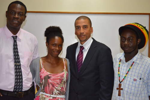 Photo: Former Trinidad and Tobago football star David Nakhid (second from right) poses for a photograph during the 2015 CFU Congress in St Maarten. (Courtesy Josanne Leonard)