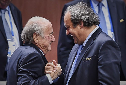 Photo: UEFA president Michel Platini (right) congratulates FIFA president Sepp Blatter after his re-election on 29 May 2015. (Copyright Michael Buholzer/AFP 2015)