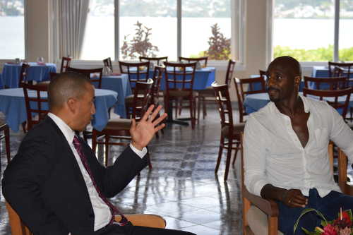 Photo: FIFA presidential candidate David Nakhid (left) talks to former Grenada football star and England Premier League forward Jason Roberts in St Maarten. (Courtesy Josanne Leonard)