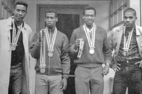 Photo: Trinidad and Tobago 4x400 metre relay team (from left) Kent Bernard, Edwin Roberts, Wendell Mottley and Edwin Skinner pose with their silver medals at the Tokyo 1964 Olympics. (Copyright Socapro)