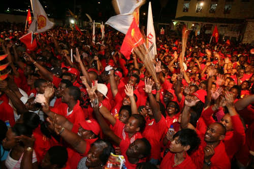 Photo: PNM supporters celebrate their 2007 General Elections victory. (Copyright Pedro Rey/AFP 2015)