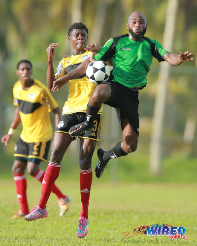 Photo: Prisons FC attacker Stephen Julien (right) tries to protect the ball from Cunupia FC midfielder Duayne Baptiste during 2015 CNG Super League action at the Youth Training Facility, Arouca. (Courtesy Allan V Crane/Wired868