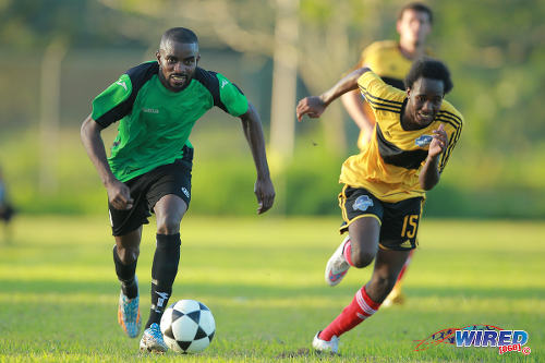 Photo: Prisons FC winger Ricardo Alleyne (left) takes on Cunupia FC defender Kyle Mack during CNG National Super League Championship Division action at the Youth Training Facility, Arouca. (Courtesy Allan V Crane/Wired868)