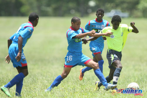 Photo: The St Ann's Rangers defence tries to keep tabs on a Santa Cruz FA attacker during North Zone Under-15 action in the Republic Bank National Youth Cup at the Queen's Park Savannah.  (Courtesy Allan V Crane/Wired868)