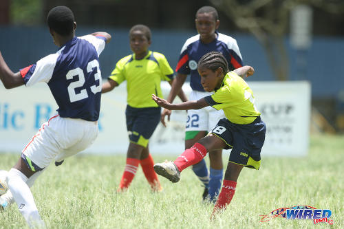 Photo: Trendsetter Hawks Under-11 attacker Quddoos Abdul Hypolite shoots for goal against the Santa Cruz Under-13s during 2015 Republic Bank National Youth Cup action at the Queen's Park Savannah. (Courtesy Allan V Crane/Wired868)