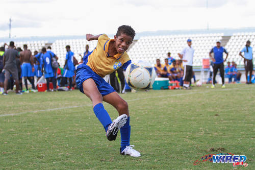 Photo: A SKHY midfielder whips in a cross during Republic Bank National Youth Cup Under-13 action at the Larry Gomes Stadium in Malabar. (Courtesy Sinead Peterds/Wired868)