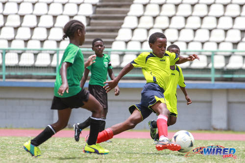 Photo: Trendsetter Hawks playmaker Luke Williams (right) looks for an opening against Uprising Youths in Republic Bank National Youth Cup Under-11 semifinal action. (Courtesy Sinead Peters/Wired868)
