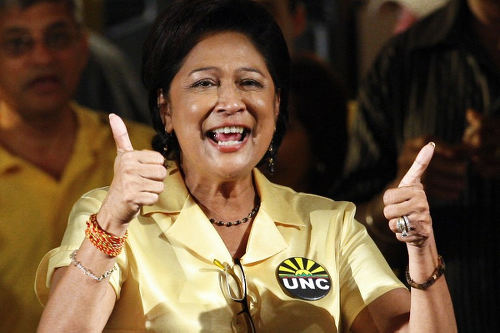 Photo: Pick me! Pick me! UNC political leader Kamla Persad-Bissessar celebrates victory at the 2010 General Elections. (Copyright Frederic Dubray/AFP 2015)