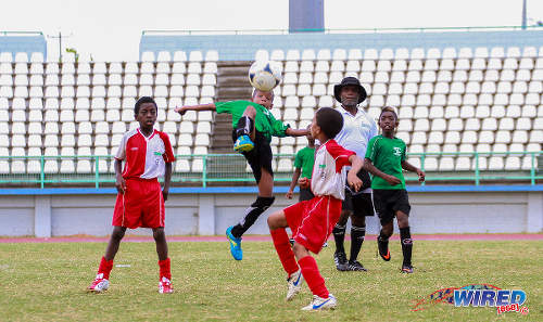 Photo: An Uprising Youths player (centre) keeps his eye on the ball against San Juan Jabloteh in the Republic Bank National Youth Cup Under-11 final at the Larry Gomes Stadium, Malabar. (Courtesy Sinead Peters/Wired868)