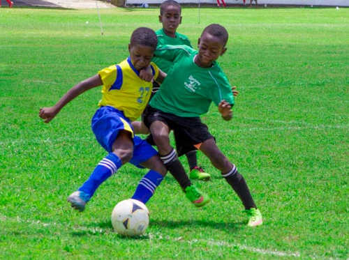 Photo: A WEZ Pro player (left) battles for the ball with an Uprising Youth opponent during Under-11 South Zone action in the Republic Bank National Youth Cup. (Courtesy Amigo Garraway/Republic Bank)