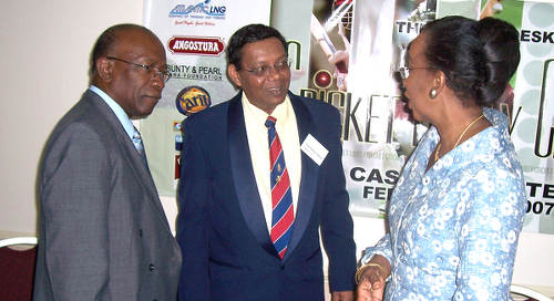 Photo: Former FIFA vice president Jack Warner (left) with his biographer and Trinidad Guardian sport editor Valentino Singh (centre). (Courtesy IWNSVG)