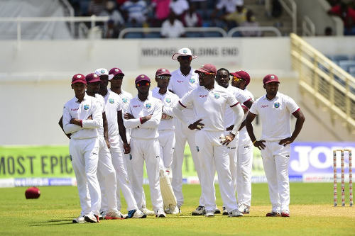 Photo: The West Indies cricket team awaits a decision during the Second Test of its home tour against Australia earlier this year. (Copyright Robyn Beck/AFP 2015)