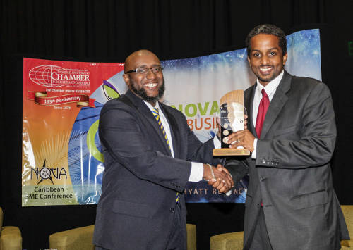 Photo: Trinidad and Tobago pollster Nigel Henry (right) receives an award for his work.