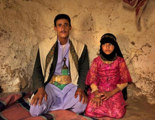 Photo: Majed, 25, (left) and his eight year old child bride, Ghana, in Yemen. (Copyright ABC News)