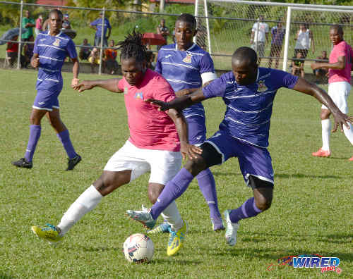 Photo: Defence Force midfielder Josimar Belgrave (right) beats Guaya United winger Collin Samuel (left) for the ball while Defence Force captain Chris Durity looks on during previous NSL action. (Courtesy DPI Photography/Wired868)