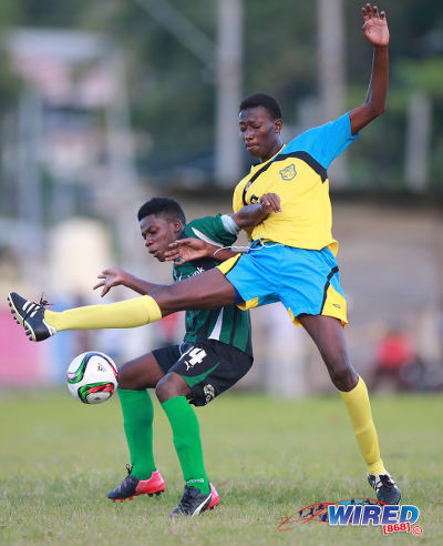 Photo: Carapichaima East Secondary's Micah Serrette (left) tries to keep the ball from Speyside High School's Elder Kamarie during SSFL action today in Speyside, Tobago. (Courtesy Allan V Crane/Wired868)