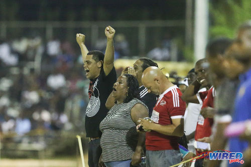 "Photo: The ""Central Choir"", accompanied by Central FC operations manager Kevin Harrison (centre), had some jovial fun at the expense of Point Fortin Civic at the Mahaica Oval in 2015 Pro League action. (Courtesy Chevaughn Christopher/Wired868)"